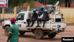 FILE - U.N. peacekeepers ride a pickup truck while on patrol in Bangui, Central African Republic, April 24, 2017, amid fears over rising ethnic tensions in the country.