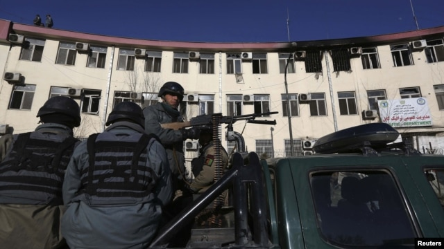 Afghan police keep watch near the Kabul traffic police headquarters that was attacked by insurgents, in Kabul, Afghanistan, January 21, 2013.
