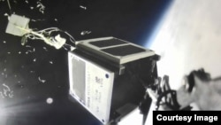"""WISA Woodsat's """"selfie stick"""" camera captured this picture just as the satellite's carrier balloon exploded, as planned, at the altitude of 31.2 kilometers. In addition to the balloon fragments, the image shows parts of the flight train and the space view"""