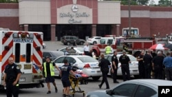 Emergency personnel gather outside the Carmike Hickory 8 movie theater following a shooting in Antioch, near Nashville, Tennessee, August 5, 2015.