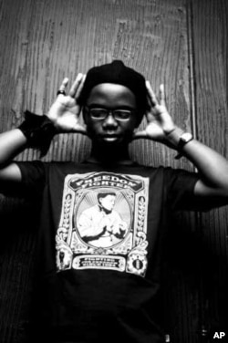 De Song wears a T-shirt bearing the image of his hero, Nelson Mandela, during a photo shoot