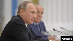 Russian President Vladimir Putin speaks during a meeting of the Lomonosov Moscow State University Supervisory Board at the Kremlin in Moscow, Russia, May 28, 2015.