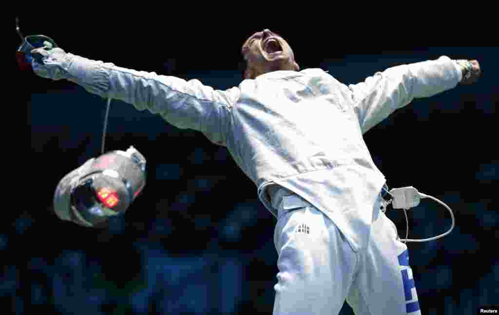 Italy's Diego Occhiuzzi reacts defeating his compatriot Aldo Montano (not seen) during their men's sabre individual round of 16 fencing competition at the ExCel venue at the London 2012 Olympic Games July 29, 2012