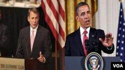 Ketua DPR AS John Boehner (kiri) telah memperingatkan Presiden Obama agar menghentikan serangan di Libya.