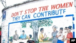 Activists say one way to help fight domestic violence in Africa would be to have more women's representation in politics, as this sign in Monrovia, Liberia, suggests