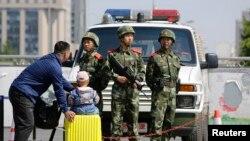 Polisi paramiliter China di Beijing. (Foto: Ilustrasi)