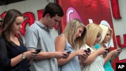 Texting can lead to strain and injury, otherwise known as text neck. Here, contestants compete in a texting championship in New York, Aug. 8, 2012.