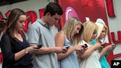 Texting can lead to strain and injury, otherwise known as text neck. Here contestants compete in a texting championship in New York, Aug. 8, 2012.