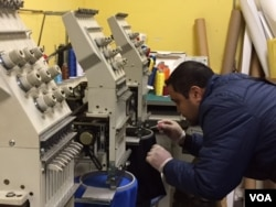 Printer Luis Bustos came to the U.S. to start his own business, something he said was not easy in Mexico. (C. Presutti/VOA)