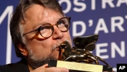 "Guillermo del Toro kisses the Golden Lion for best film for ""The Shape Of Water"" during the awards photo call at the 74th Venice Film Festival at the Venice Lido, Italy, Sept. 9, 2017."