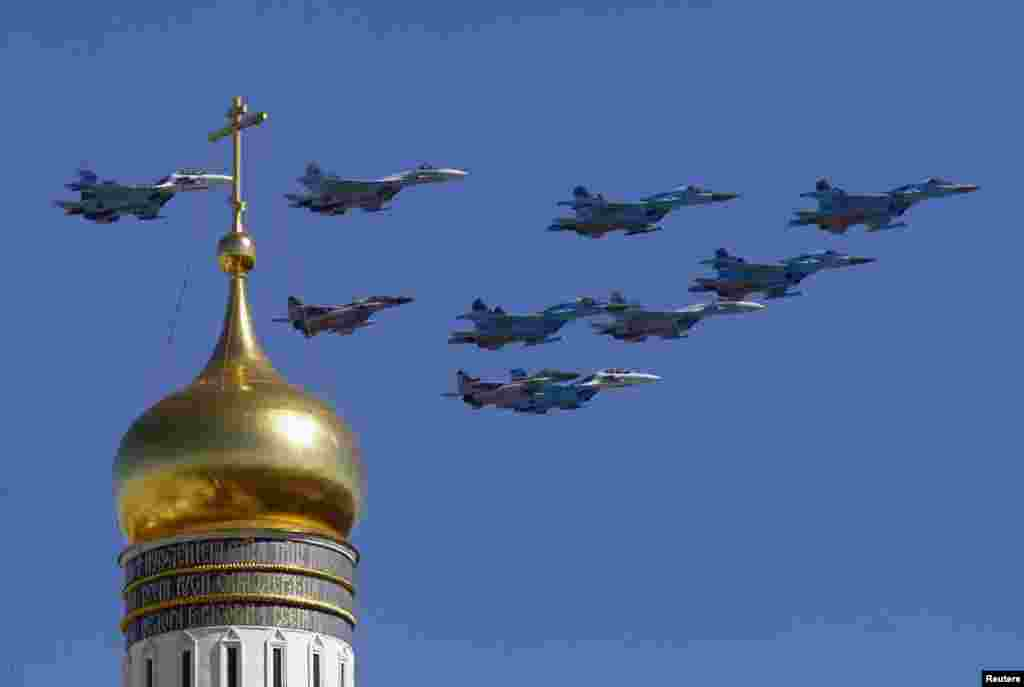 Military jets fly over an Orthodox Christian church during a rehearsal for the Victory Day parade in Moscow. Russia marks victory over Nazi Germany in World War II every year on May 9.