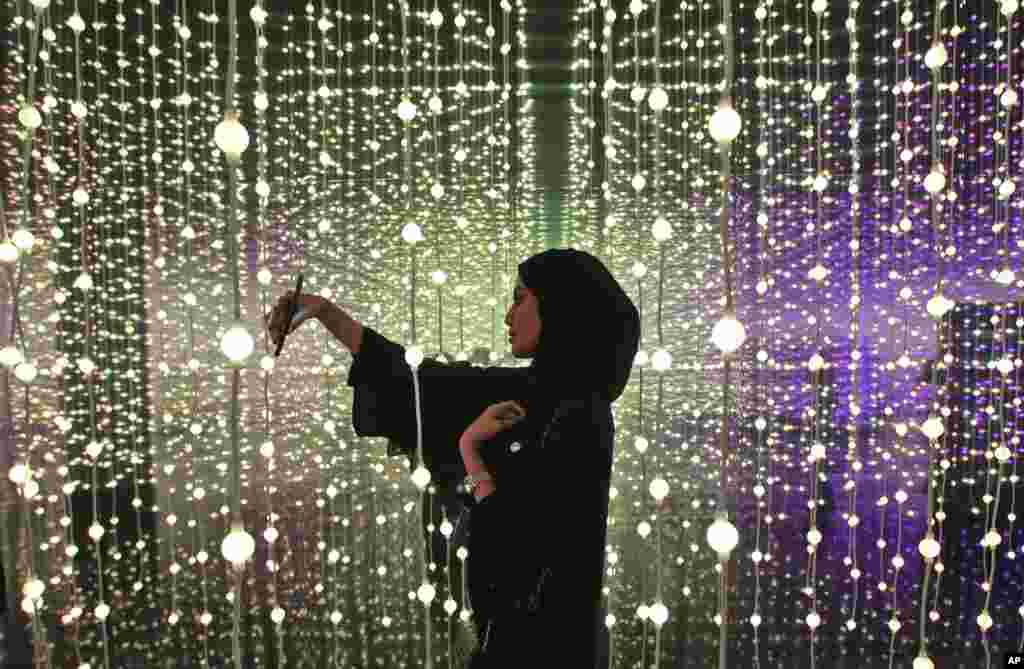 A woman takes a selfie at the Museum of the Future of the World Government Summit in Dubai, United Arab Emirates.