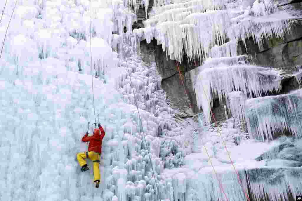 A man climbs up a fake ice wall in Liberec, Czech Republic.