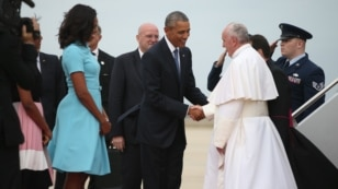 President Barack Obama and first lady Michelle Obama greet Pope Francis upon his arrival at Andrews Air Force Base, Maryland, Sept. 22, 2015.