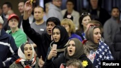 FILE - Young Muslims protest U.S. Republican presidential candidate Donald Trump before they were escorted out during a campaign rally in Wichita, Kansas, March 5, 2016.