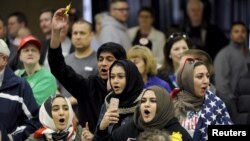 FILE - Young Muslims protest U.S. Republican presidential candidate Donald Trump before being escorted out during a campaign rally in Wichita, Kansas, March 5, 2016.