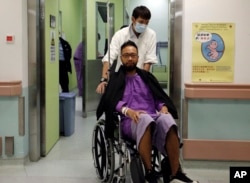 Ken Tsang, a member of a local pro-democracy political party, is admitted at a hospital for a medical exam after sustaining injuries during a clash between protesters and police in an occupied area near government headquarters in Hong Kong, Oct. 15, 2014.