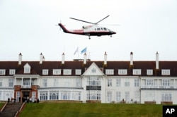 FILE - Presidential contender Donald Trump leaves by his helicopter on the third day of the Women's British Open golf championship at the Turnberry golf course in Turnberry, Scotland, Aug. 1, 2015.