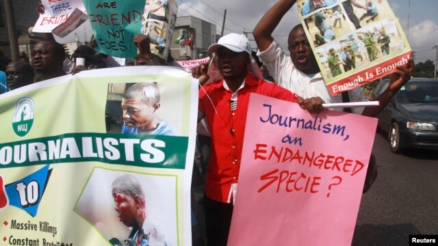 Journalists hold placards as they protest along a road days after a journalist was assaulted by mortuary attendants at the Lagos State University Teaching Hospital in Lagos, (File photo).