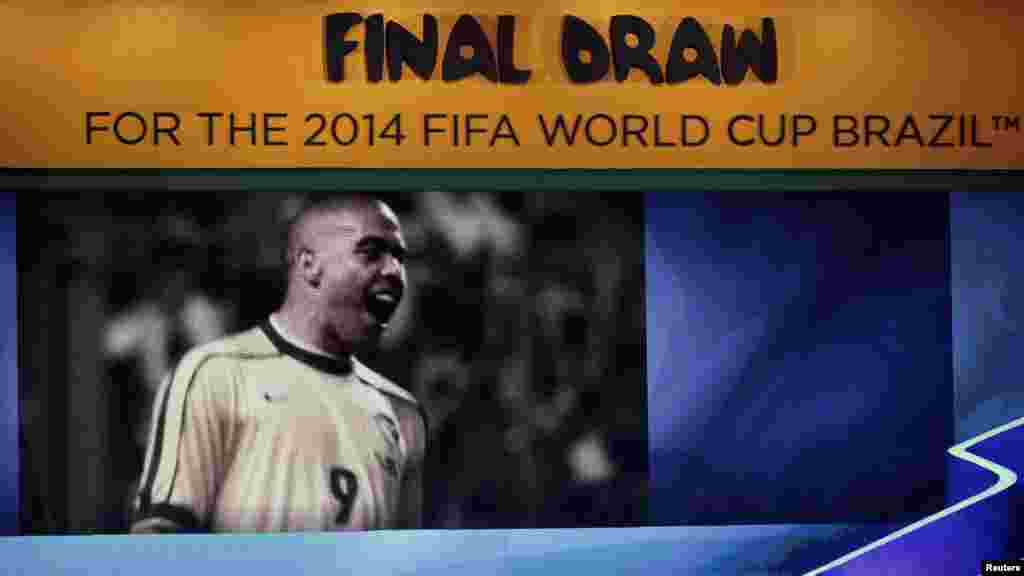 Former Brazil soccer player Ronaldo speaks on stage during the draw for the 2014 World Cup.