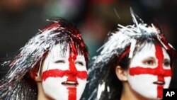 Two young England football supporters, their faces painted with the St George's Cross, at a World Cup qualifying match in London in 2009