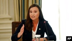 FILE - Florida Attorney General Ashley Moody speaks during a roundtable discussion at the White House in Washington, June 8, 2020.