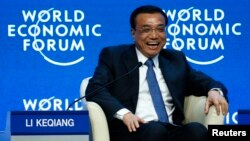"""Chinese Premier Li Keqiang reacts during an event titled """"The Global Impact of China's Economic Transformation"""" at the World Economic Forum in Davos, Switzerland, Jan. 21, 2015."""