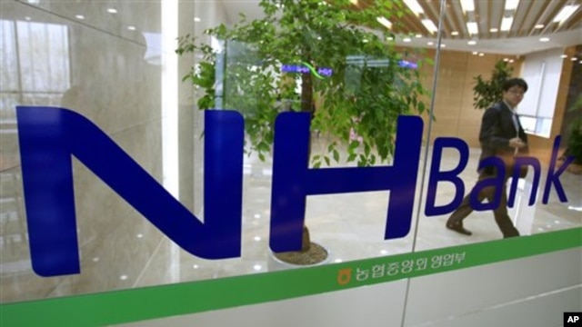 A customer leaves a branch of the Nonghyup bank in Seoul, South Korea,May 3, 2011.