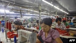 Myanmar laborers work in a garment factory on the outskirts of Yangon.