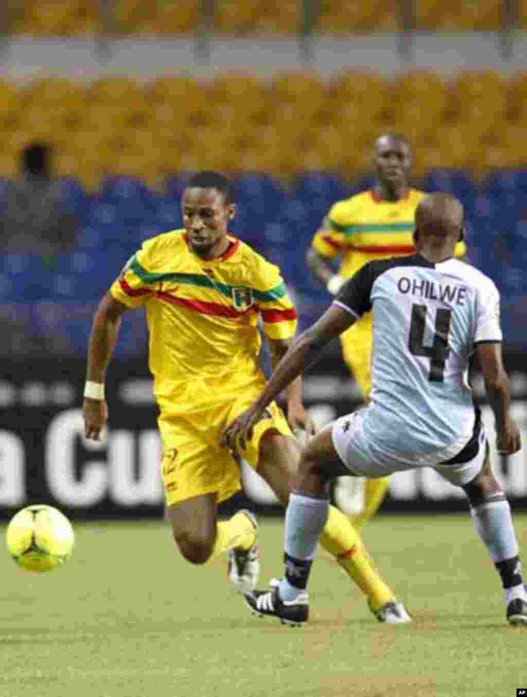 Mali's Seydou Keita (12) plays against Botswana's Mmusa Ohilwe during their final African Cup of Nations Group D soccer match at the Stade De L'Amitie Stadium in Libreville February 1, 2012.
