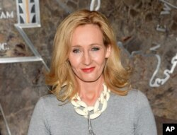 """FILE - """"Harry Potter"""" author J.K. Rowling lights the Empire State Building to mark the launch of her non-profit children's organization Lumos, in New York, April 9, 2015."""