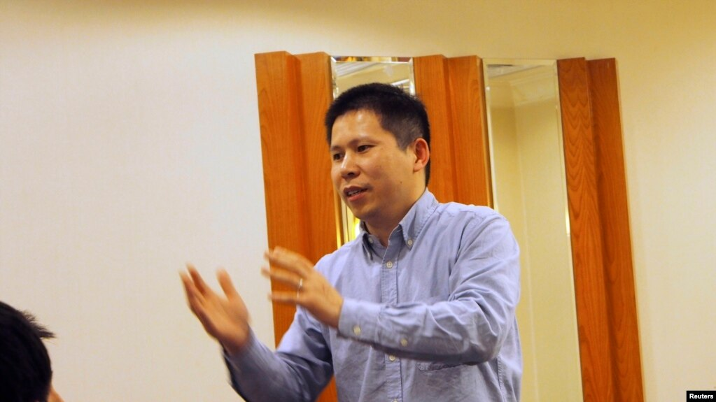 Nhà hoạt động nhân quyền Hứa Chí Vĩnh tại một mít tinh ở Bắc Kinh (ảnh tư liệu, 3/2013)