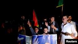 : 2014年9月21日,阿富汗总统候选人加尼的支持者喀布尔街头庆祝加尼成为后任总统。