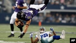 In the 2014 file photo, Baltimore Ravens' football player Kyle Juszczyk (44) goes flying after a collision in an NFL preseason football game. Football players can suffer from brain disorder after being hit in the head many times. (AP Photo/Brandon Wade)