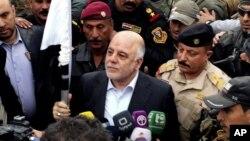 Премьер-министр Ирака Хайдер Абади (в центре)