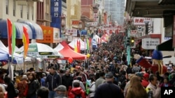 Crowds jam Chinatown during a Chinese New Year festival, Feb. 20, 2016, in San Francisco, California.