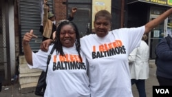 Residents of the Sandtown neighborhood in Baltimore, Maryland react to the State's Attorney's announcement ruling Freddie Gray's death a homicide, May 1, 2015. (Photo: C. Simkins / VOA)