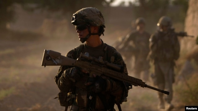 US Army soldiers patrol in the Afghan village of Chariagen in the Panjwai district of Kandahar province on June 22 , 2011.