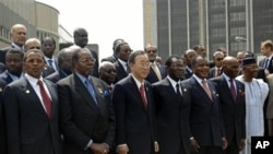 Malawi President and president of African Union Bingu wa Mutharika, front second left, stands with UN Secretary General Ban Ki-moon, as they pose for a group photo with other African heads of states at the AU summit in Addis Ababa, Ethiopia, January 30, 2
