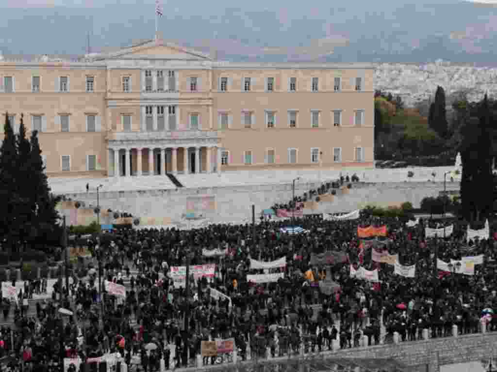Demonstrators rally in front of Parliament in Athens on February 10, 2012. (AP)