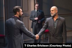 Israeli negotiator Uri Savir (Michael Aronov) shakes hands with his Palestinian counterpart, Ahmed Qurie (Anthony Azizi) in a scene from Oslo