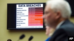FILE - A chart of data breaches is shown on Capitol Hill in Washington, June 16, 2015, as witnesses testify before the House Oversight and Government Reform Committee's hearing on the Office of Personnel Management data breach.
