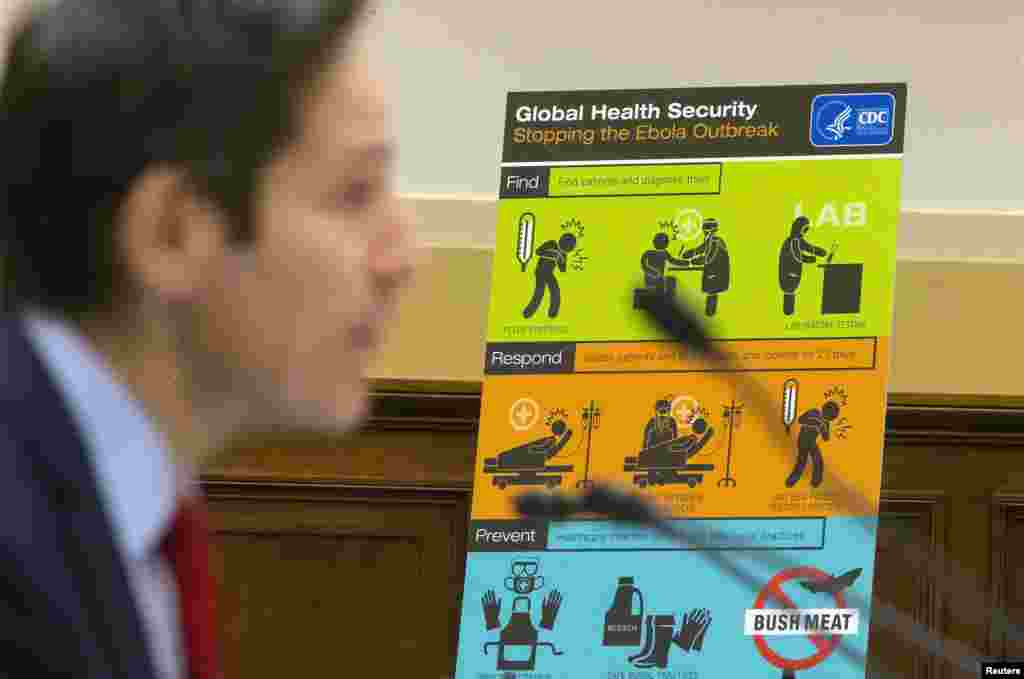 U.S. Centers for Disease Control and Prevention (CDC) Director Tom Frieden displays CDC educational materials as he testifies about the Ebola crisis in West Africa during a hearing of a House Foreign Affairs subcommittee on Capitol Hill, in Washington, DC, Aug. 7, 2014.