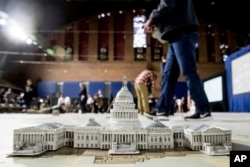 A model of the Capitol is displayed on a giant planning map during a media tour highlighting inaugural preparations being made by the Joint Task Force-National Capital Region for military and civilian planners at the D.C. Armory in Washington, Dec. 14, 2016.