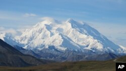 FILE - Denali, Mt. McKinley at the time, is seen on a sunny day Aug. 19, 2011, in Denali National Park, Alaska. Denali is the highest mountain peak in North America and the United States, with a summit elevation of 6,194 meters (20,320 feet).