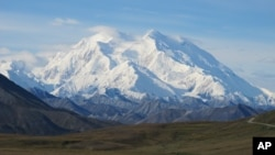 Mt. McKinley is seen on a rare sunny day this summer on Friday, Aug. 19, 2011, in Denali National Park, Alaska. Mt. McKinley is the highest mountain peak in North America and the United States, with a summit elevation of 20,320 feet (6,194 m) above sea level. (AP Photo/Becky Bohrer)
