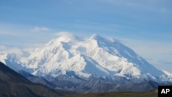 FILE - Mt. McKinley in Denali National Park, Alaska, is seen on a sunny day.