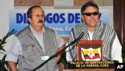 FILE - Jesus Santrich (R) of the Revolutionary Armed Forces of Colombia with fellow FARC member Andres Paris during peace talks in Havana.