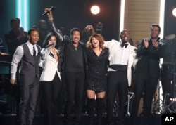 John Legend, from left, Demi Lovato, Lionel Richie, Meghan Trainor, Tyrese, and Luke Bryan perform a tribute to MusiCares Person of the Year honoree Lionel Richie at the 58th annual Grammy Awards, Feb. 15, 2016, in Los Angeles.