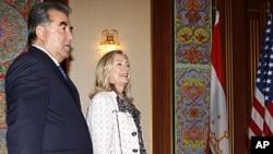 U.S. Secretary of State Hillary Clinton, right, walks alongside Tajikistan's President Emomali Rakhmon at the Palace of the Nation in Dushanbe, Tajikistan, Oct. 22, 2011.